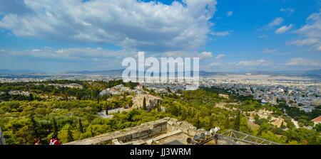View of the city of Athens Greece from the hill at the Acropolis on a warm summer day - Stock Photo