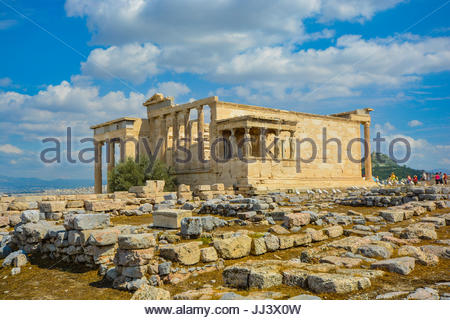 View of the Erechtheion temple at the Athens Acropolis in Athens Greece on a warm summer day with Lykavittos Hill - Stock Photo