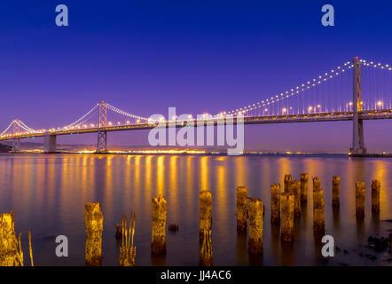 Oakland Bay Bridge at night from The Embarcadero , San Francisco California , USA - Stock Photo