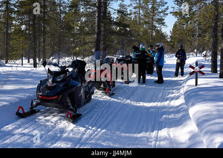 Snowmobiling to the Fells in Urho Kekkonen National Park, Saariselka, Finland - Stock Photo