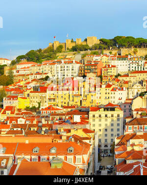 View of Lisbon with Lisbon Castle on top of a hill at sunset. Portugal - Stock Photo