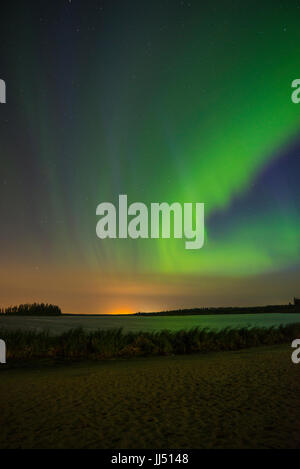 Northern Lights (Aurora Borealis) over Astotin Lake in Elk Island National Park, Canada - Stock Photo