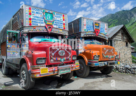 Jammu and Kashmir, India. Two trucks parked outside Sonamarg. Part of a convoy waiting to depart for Kargil. - Stock Photo