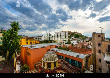 Athens Greece view of the Acropolis and Parthenon on a late afternoon in the summer from a window in the Plaka district - Stock Photo