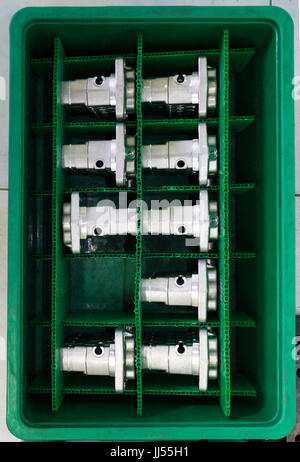Automotive Aluminium parts kept in a green plateic box ; parts produced by Low Pressure Die casting process and - Stock Photo