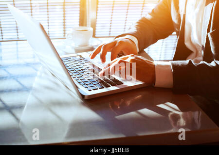 business travel, working on computer laptop online, closeup of hands of businessman, person using wifi internet - Stock Photo
