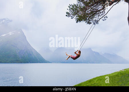 romantic girl on the swing, sweet dreams, daydream concept background - Stock Photo