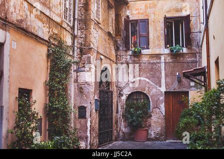 travel to Rome, cozy european courtyard, street in Italy - Stock Photo