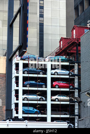 Car stack parking in New York saves space but can take longer to retrieve your vehicle - Stock Photo