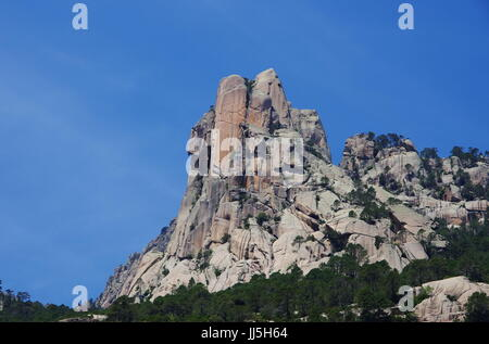 The vertical Punta Lunarda, in the Aiguilles de Bavella range in Corsica - Stock Photo