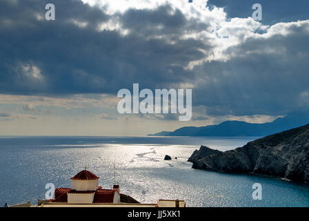 Greece, Aegean Islands, Karapthos island, Sunset at scenic beach of Agios Minas. - Stock Photo