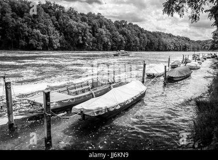 Boats in Rows on the Rhine river near the Rhinefalls, Schaffhausen, Switzerland. Sony Alpha 7 MK II f/6.3 1/1600s - Stock Photo