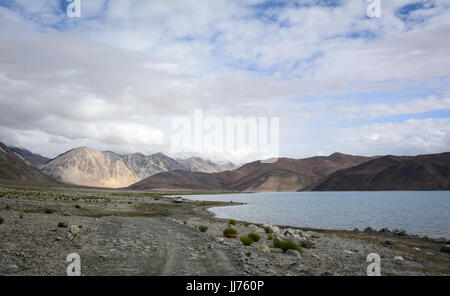 Pangong Lake at sunrise in Ladakh, India. Pangong is an endorheic lake in the Himalayas situated at a height of - Stock Photo