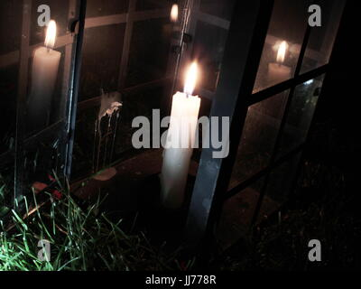 lonely candle light - Stock Photo