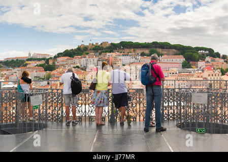 Lisbon Mouraria, from the observation platform on top of the Elevador Santa Justa tourists view the skyline of the - Stock Photo