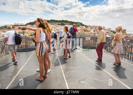 Lisbon tourists, visitors to the Elevador Santa Justa in the centre of Lisbon look out from the observation platform - Stock Photo