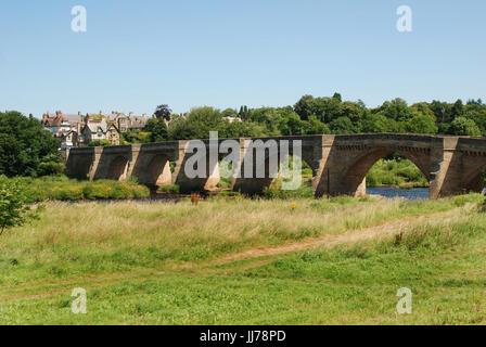 historic seven arched bridge at Corbridge over river Tyne - Stock Photo