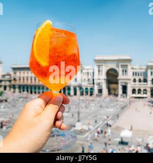 Spritz aperol drink in Milan overlooking Piazza Duomo - Stock Photo