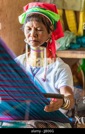 A woman from Padaung tribe (the group in which women wear the brass neck coils), Inle Lake, Shan State, Myanmar - Stock Photo