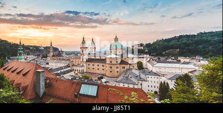Panoramic view of beautiful Salzburg in Austria at sunset - Stock Photo