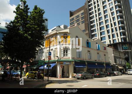 Traditional three-storey shophouse buildings on corner of Telok Ayer Street and Amoy Street, Singapore - Stock Photo