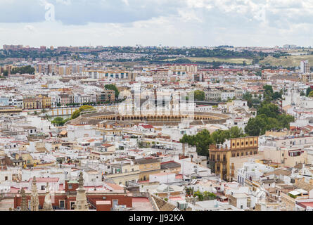 Aerial view of Seville with a focus on Seville's bullring, Plaza de toros de la Real Maestranza de Caballería. Construction - Stock Photo