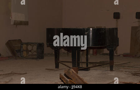 Abandoned Piano in Devastated Room in Ghost City of Pripyat in Chernobyl Exclusion Zone - Stock Photo