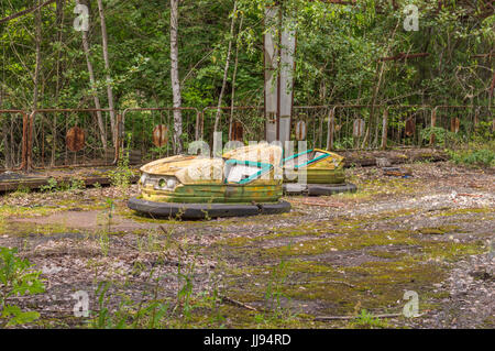 Abandoned Amusement Car Ride in Ghost City of Pripyat in Chernobyl Exclusion Zone - Stock Photo