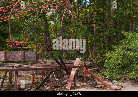 Chernobyl Exclusion Zone: Abandoned Carousel in Ghost City of Pripyat - Stock Photo