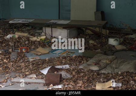 Abandoned School Classroom in Ghost City of Pripyat in Chernobyl Exclusion Zone - Stock Photo