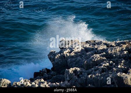 Coastal Scene - waves against rocks - Stock Photo