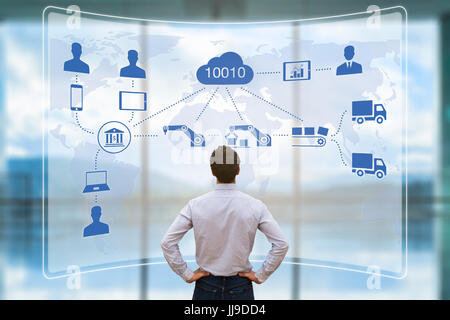 Manager looking at augmented reality (AR) screen showing smart factory or industry 4.0 automated manufacturing connected - Stock Photo
