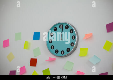 Colorful Sticky notes with clock on wall - Stock Photo