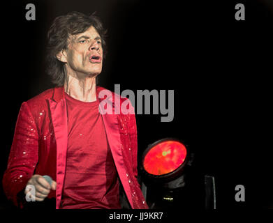 Mick Jagger Rolling Stones on stage in red jacket - Stock Photo