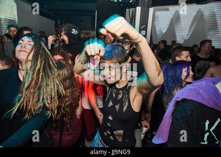 BRISTOL, UK - NOVEMBER 2016: A young, attractive woman with tattoos and short hair, makes fists to the camera as - Stock Photo