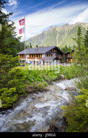 The Relais d'Arpette, a mountain hut near Swiss Champex, on the Tour du Mont Blanc, a classic multi day hike that - Stock Photo