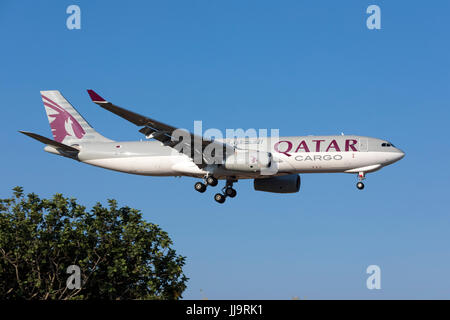 Qatar Airways Cargo Airbus A330-243F [REG: A7-AFJ] coming in to landing runway 31 in the morning, direct from Doha, - Stock Photo