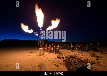 A homemade flame effects shoots propane fireballs into the night sky at the High Sierra Fly In event int eh Nevada - Stock Photo