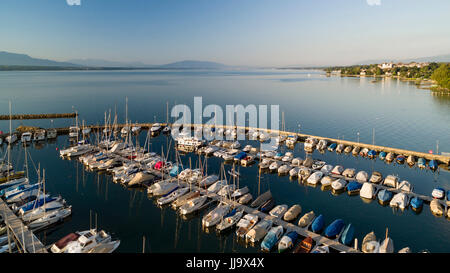 aerial view on Geneva Lake and the marina in Prangins with many boats anchored and a view in the right-hand side - Stock Photo
