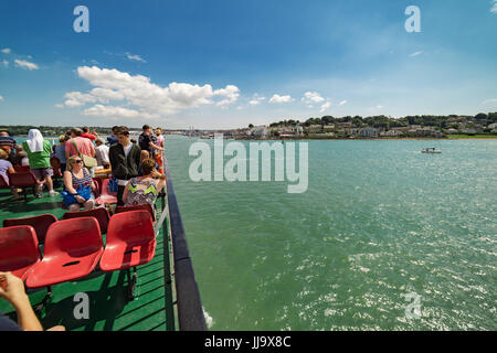 Passengers on the upper deck of the Red Funnel ferry service between Southampton and Cowes on the Isle of Wight - Stock Photo