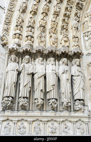 Stone Statues Carved on the facade of Notre Dame Cathedral, Paris, France - Stock Photo