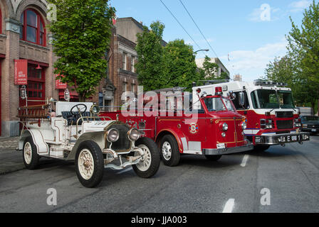 Vintage to modern fire engines on outdoor display, Vancouver City. - Stock Photo