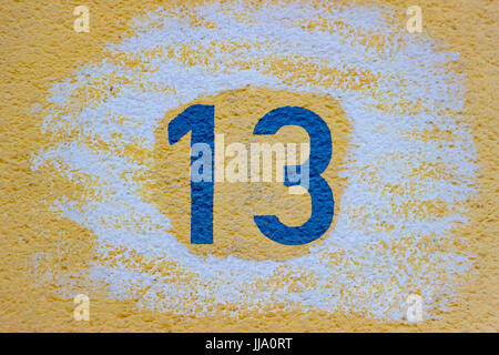House Number Thirteen in Detail as Background - Stock Photo