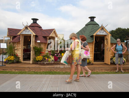 Knutsford Cheshire, UK. 19th July, 2017. Lapland wooden huts at Tatton Park Flower show. Credit; MediaWorldImages/AlamyLiveNews - Stock Photo