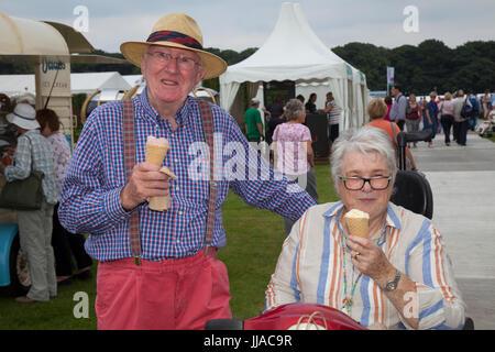Knutsford Cheshire, UK. 19th July, 2017. Enjoying ice-cream at Tatton Park Flower show. Credit; MediaWorldImages/AlamyLiveNews - Stock Photo
