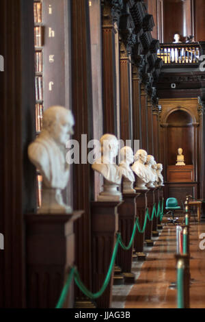 Line of busts in the long room in Trinity College, Dublin Ireland - Stock Photo