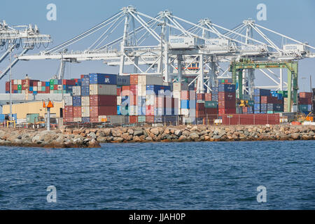 Container Ship, COSCO America, Being Unloaded In The Port of Long Beach, California, USA. - Stock Photo