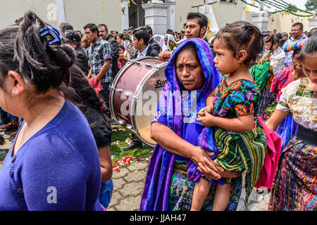 Parramos, Guatemala - May 29, 2016: Traditionally dressed Mayan women & girl participate with other locals in Catholic - Stock Photo