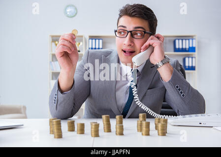 Businessman with golden coins in business growth concept - Stock Photo