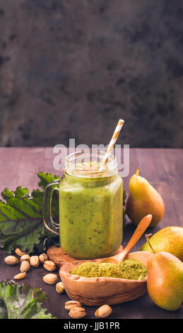 Jar of green smoothie with fresh kale - Stock Photo